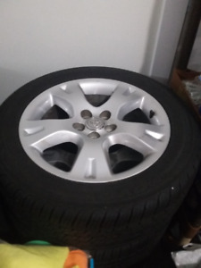 4 16inch Toyota Matrix Alloy rims with all season tires