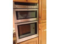 Neff brushed chrome double fan oven with grill