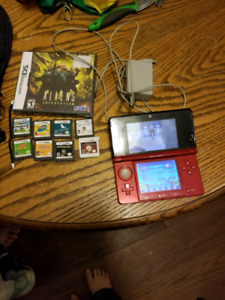 3DS with 9 games, charger, sd, 2 stylus, and carrying case