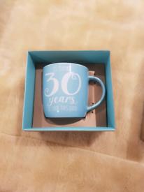Tea mug in box and photo frame