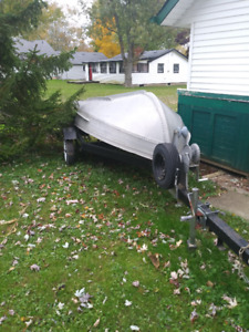 12 ' Aluminium Boat and Trailer; and 9.5 Vintage Johnson Motor