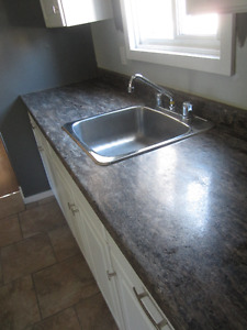 Laminate countertops with sink and faucet. Like new! No cabinets