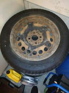 "4 winter tires on rims 4x100 15"""
