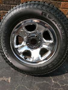 265/70R17 Dodge Ram 1500 winter tire A/T pkg OEM wheels and tire