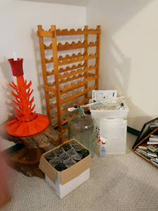 Wine making equipment, bottles and wooden wine rack