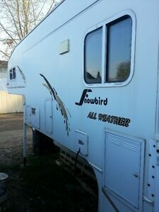 """2004 Snowbird 10'6"""" All weather truck camper with slide-out"""
