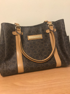 Brand new Calvin Klein purse with tag, never worn