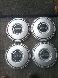 Ford/Mercury dog dish hubcaps. Two sets.