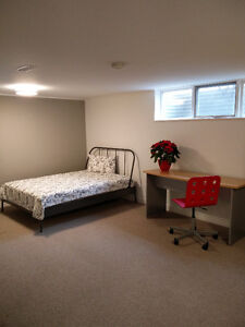 Large newly renovated LEGAL, basement room is available now