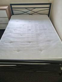 19. Black metal bed frame and mattress