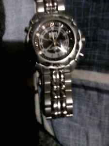 ROOTS STEEL WATCH. DIGITAL AND SWEEPING.   RAND NEW