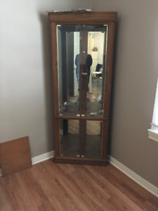 PRICE REDUCED FOR QUICK SALE! ! Corner Curio Cabinet for sale.