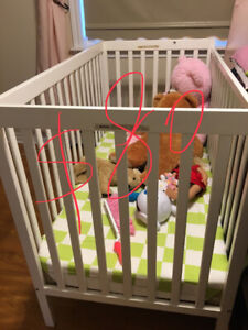 Buy baby bed and mattress, two  sets of crib sheets for free!