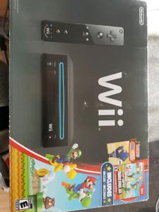 Wii complète avec 2 manettes plus joy stick +++