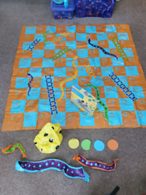 Giant snakes and ladders toy game outdoors
