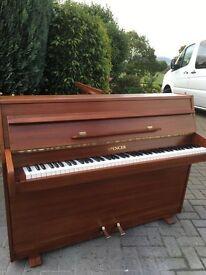 Small modern upright piano by Spencer light walnut