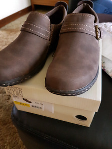 Brown slip on shoes.