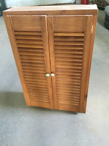 Small wood cabinet with Louvre shutter doors