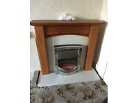 Oak fire surround with marble hearth and backing