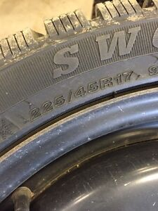 225/45/17 four used winter tires and steel wheels