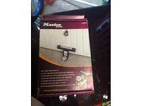 Master lock garage door defender