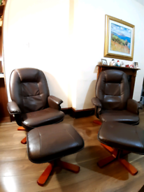 Two leather folding armchairs with footstool