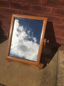 Mirror on pine stand