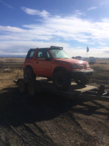 Looking for a tracker or side kick or sunrunner or jeep