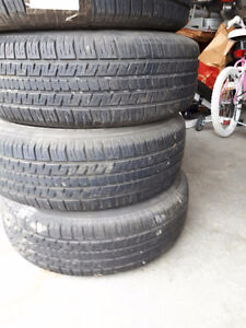 FOUR 205/70r15 tires WITH steel rims (off 2003 Buick century)