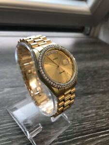 Geneve Day-Date in 14K Yellow Gold 36mm, Champagne Dial.