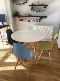 White round dining room table and 4 chairs