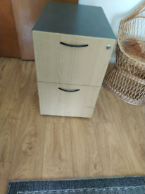 Two draw filing cabinet on casters.