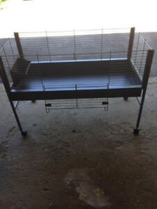 Open pet cage with rubber mat