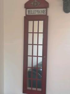 Telephone booth mirror