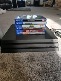 1TB PS4 Pro, games controllers and charging dock