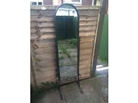 Black wrought iron stand and mirror