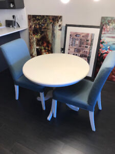 White solid wood 36 inch' pedestal table and 2 chairs.