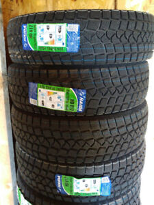 New 235/75R15 winter tires, $470 for 4