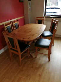 Solid pine extendable table and six solid pine chairs.