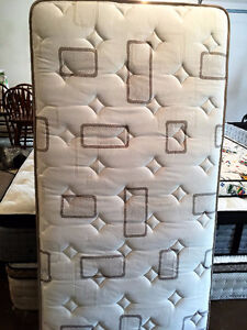 Used single mattress and boxspring for sale