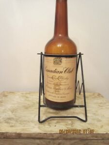 LARGE VINTAGE WHISKEY BOTTLE WITH STAND