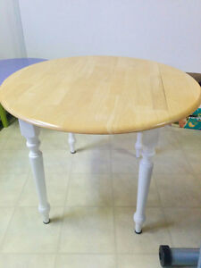 Round, Solid Wood Table w/ Folding Sides