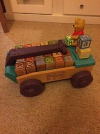 Winnie the Pooh pull along toy with bricks