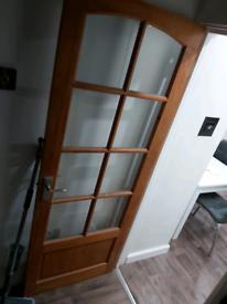 Wood doors with 8 panel glass