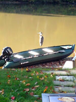 Zodiac style inflatable boat with 9.9 HP four stroke outboard