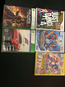 Wii games mario and sonic olympics, gears of war, just dance,