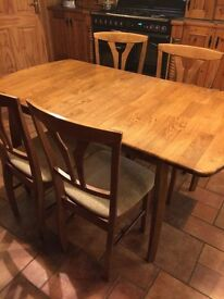 Solid wood extendable dining table and four chairs
