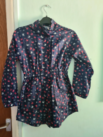 Girls foldaway rain jacket with hood and pockets age 9-10 years