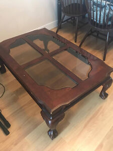 Carved Dark Wood and Glass Pane Coffee Table $65