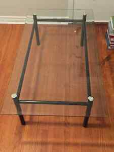 Black framed glass topped coffee table